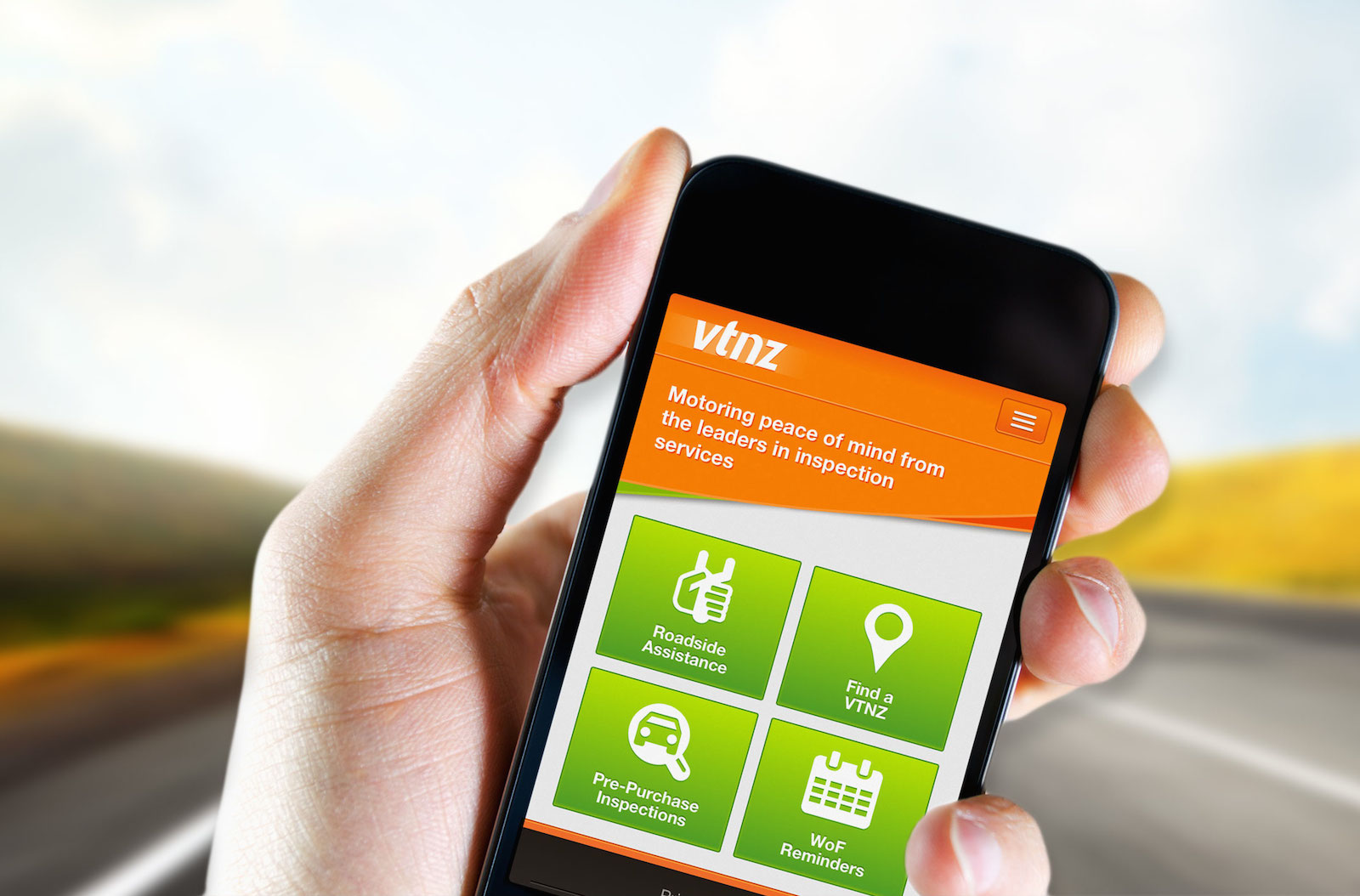 Photo of hand holding a mobile phone showing the VTNZ mobile website